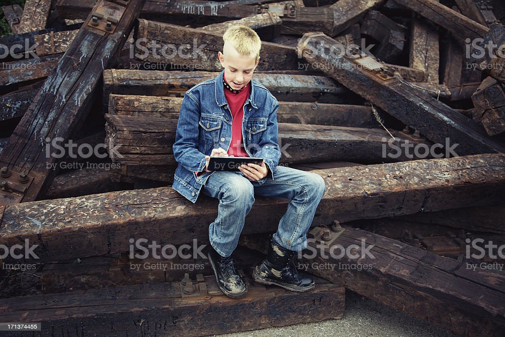 teenage boy using tablet pc stock photo