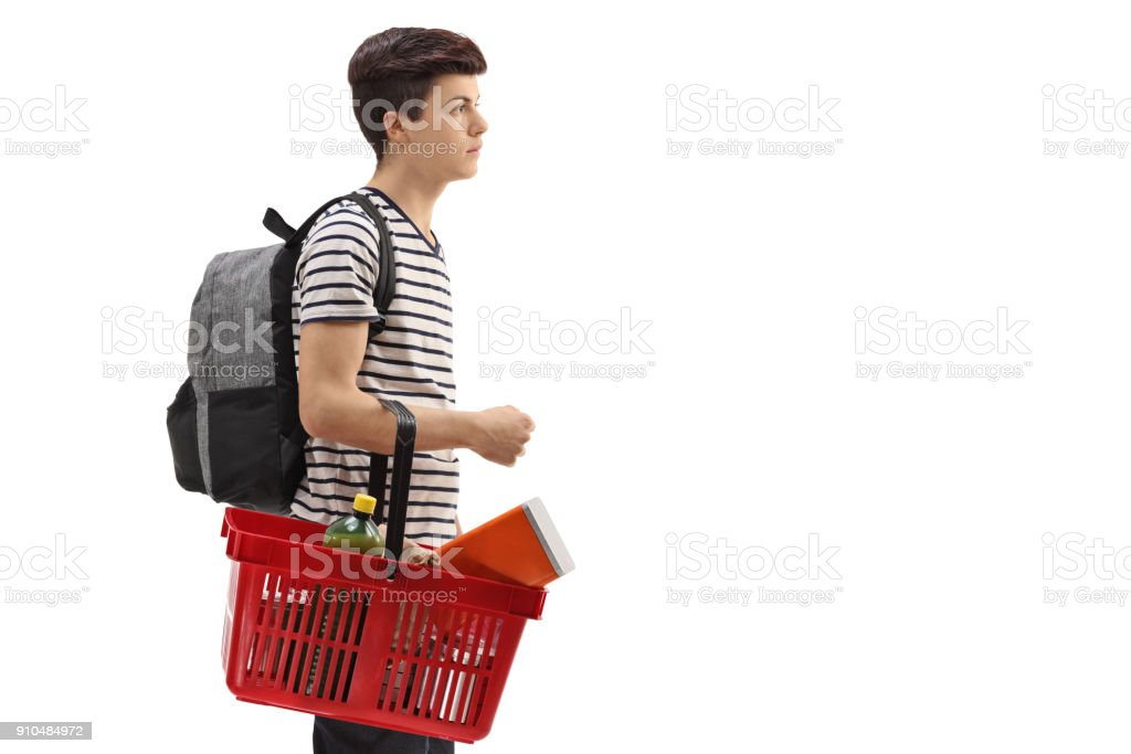 a49cf0212 Teenage Boy With A Backpack And A Shopping Basket Stock Photo & More ...