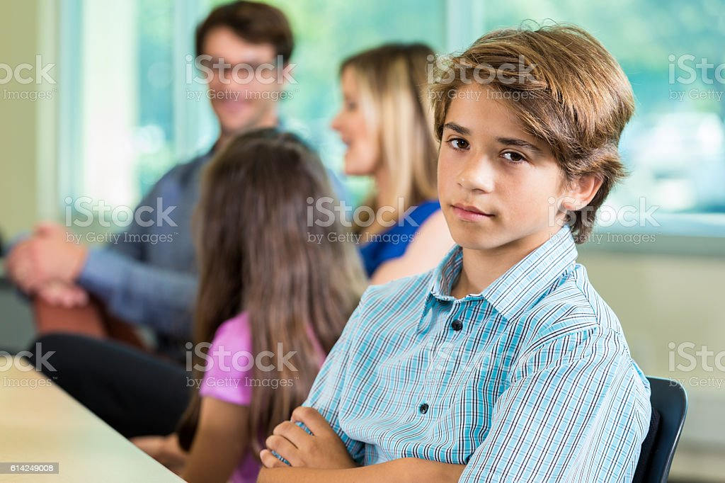 Teenage boy with attitude at parent teacher conference stock photo