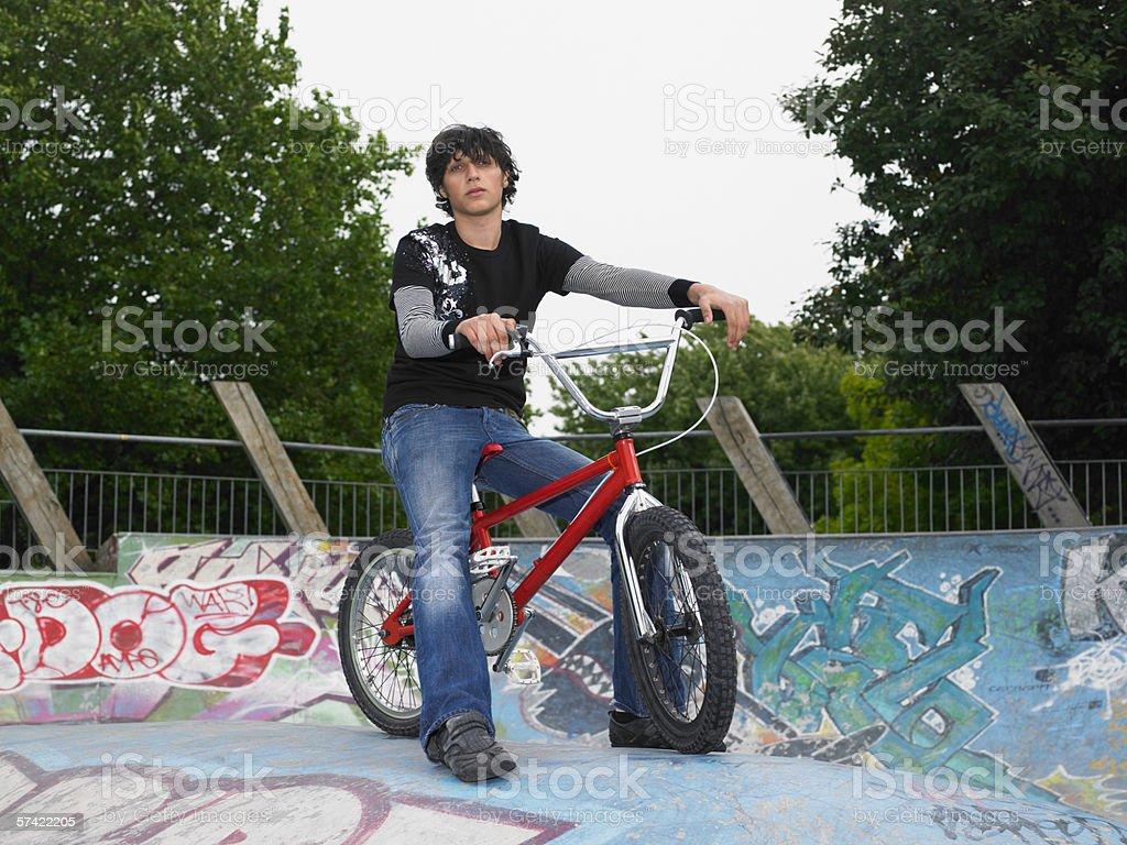 Teenage boy with bmx stock photo