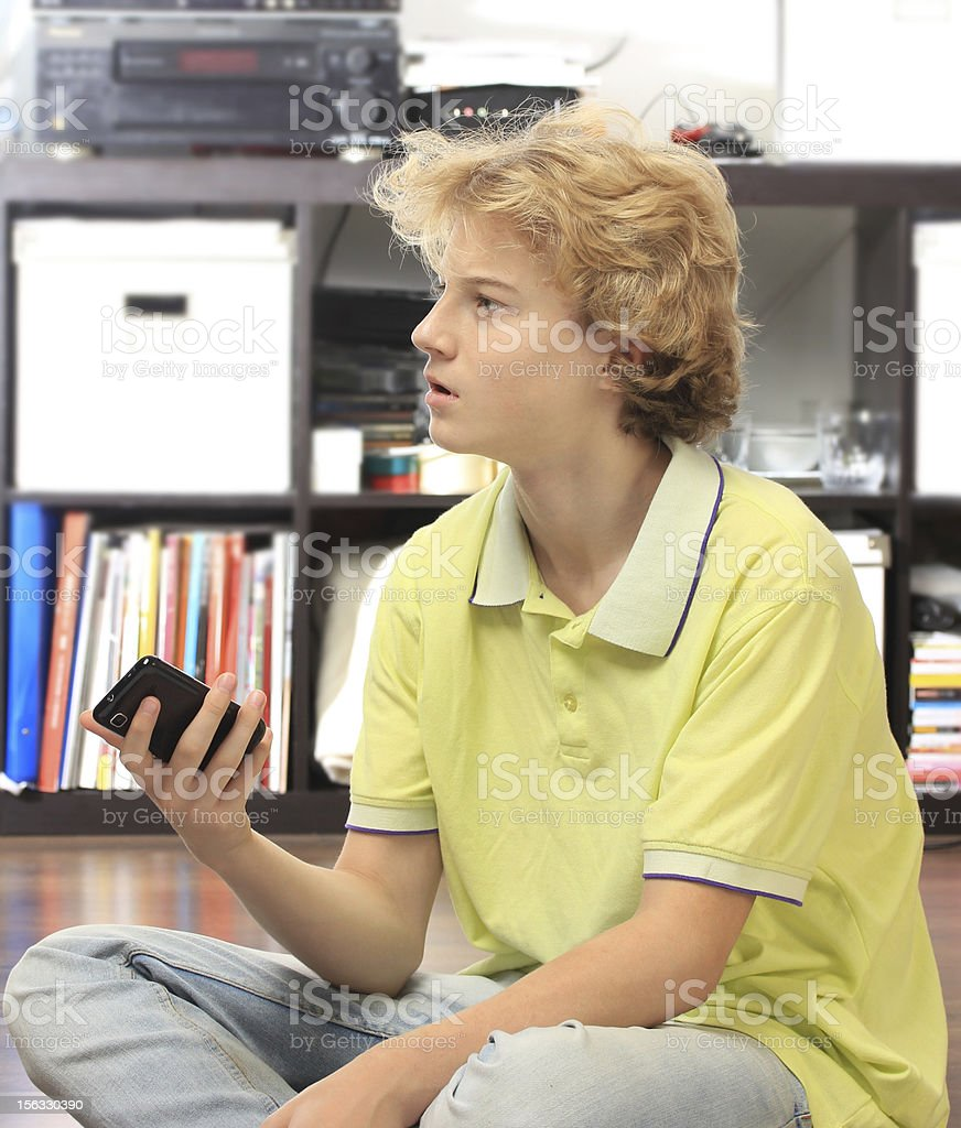 Teenage boy with cell phone royalty-free stock photo