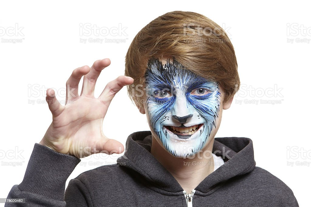 Teenage boy with face painting wolf royalty-free stock photo