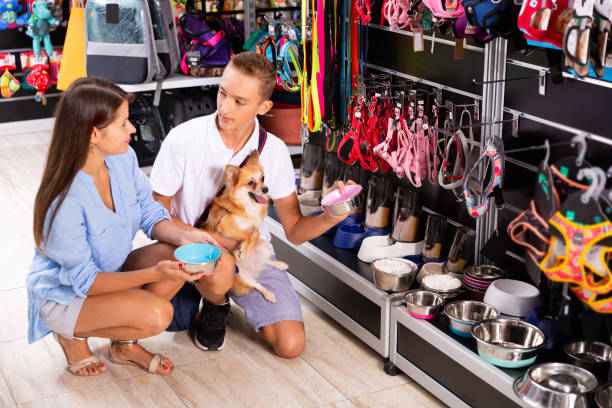 teenage boy with mother in petshop - pet shop and dogs not cats stock pictures, royalty-free photos & images