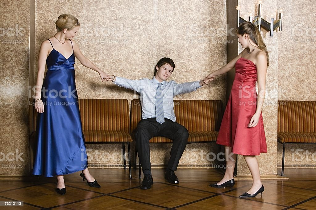 Teenage boy with two teenage girls royalty-free stock photo