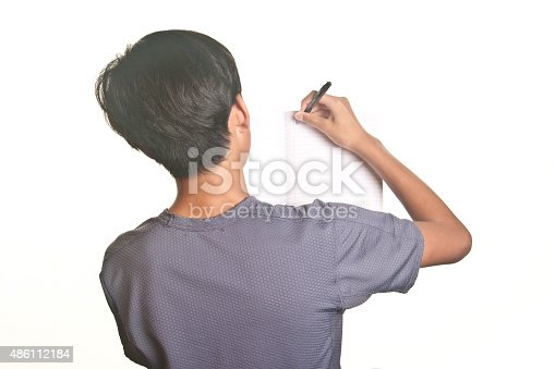 istock Teenage Boy writing on a blank page notebook 486112184