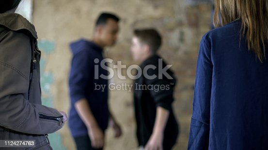 istock Teenage boys fighting, bullying and self-defense, violence, blurred background 1124274763