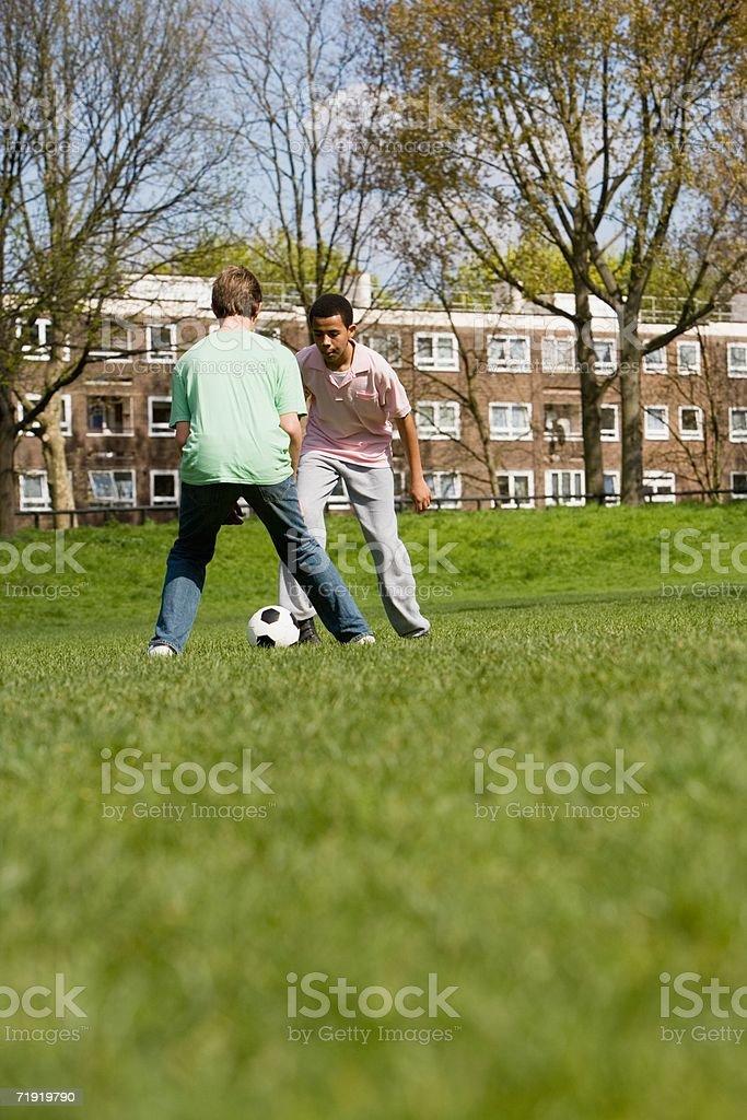 Teenage boys playing football royalty-free stock photo