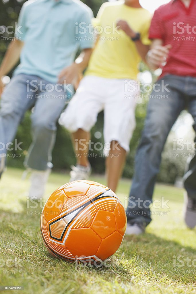 Teenage boys playing soccer together royalty-free stock photo