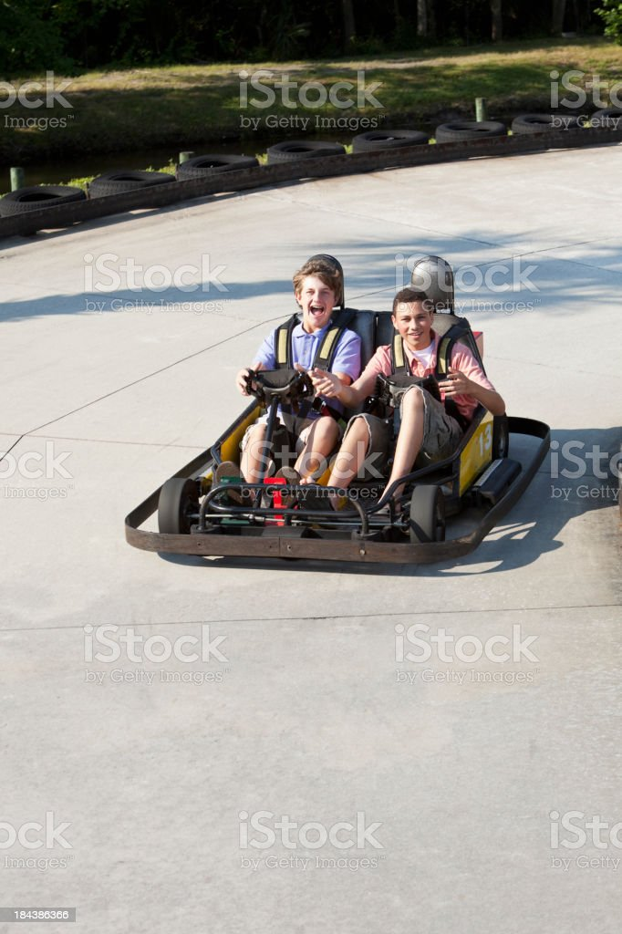 Teenage boys riding go-carts royalty-free stock photo