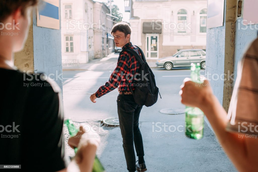 teenage bullying scared geek street gang stock photo