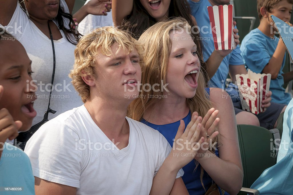 Teenage couple at the football game - II royalty-free stock photo