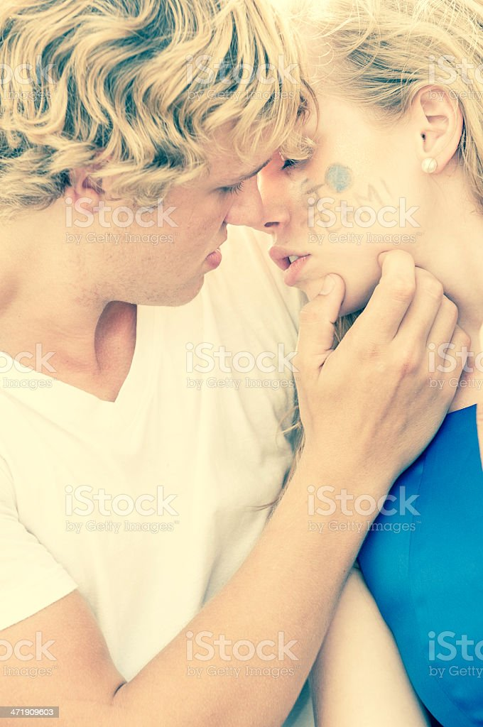 Teenage couple at the football game - VII royalty-free stock photo