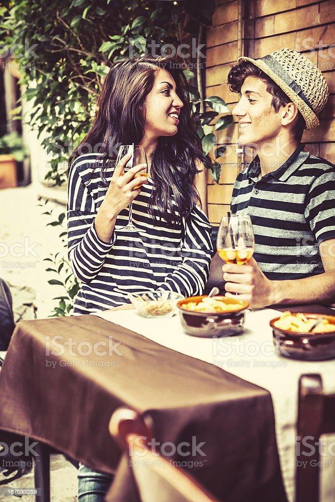 Teenage Couple Enjoying Time Together at the Cafe stock photo