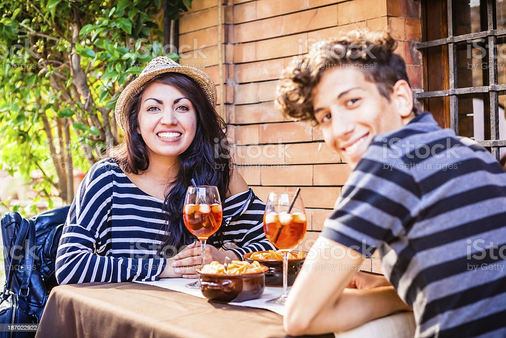 Teenage Couple Having Aperitif in Italy royalty-free stock photo