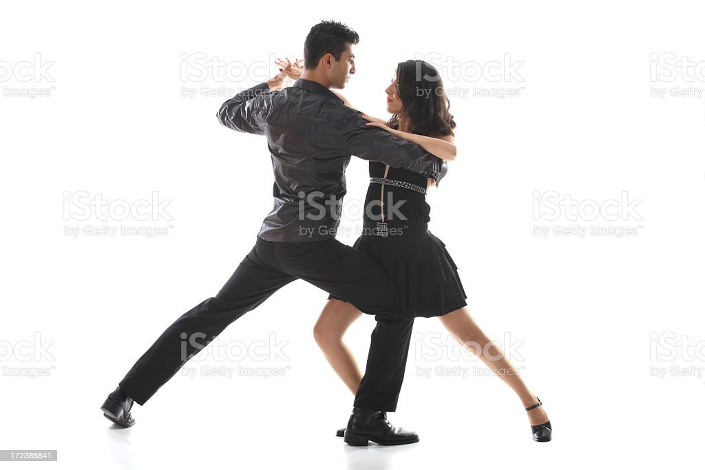 A teenage couple hold a salsa dancing pose royalty-free stock photo