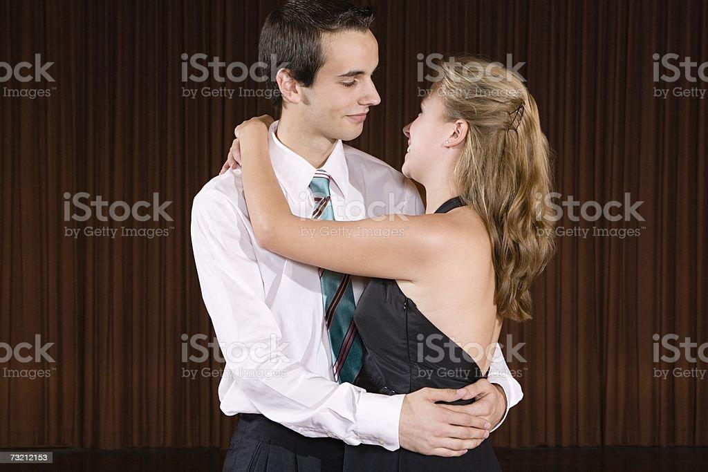 Teenage couple slow dancing stock photo