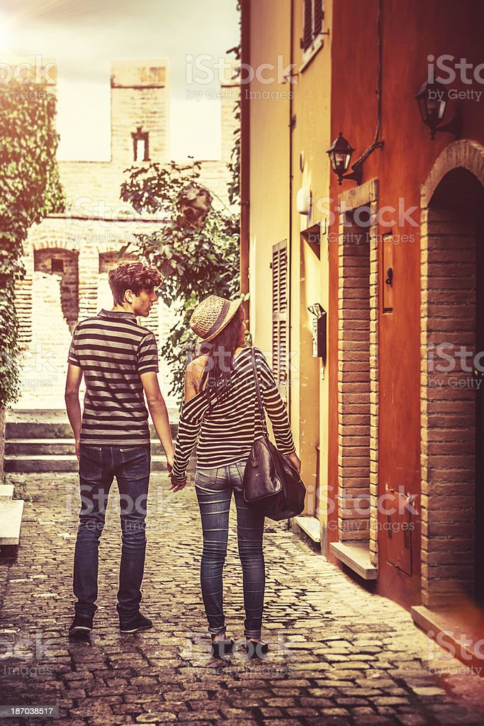 Teenage Couple Visiting an Ancient Town in Italy royalty-free stock photo