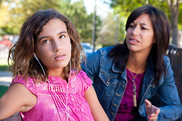 Teenage daughter looking away from her concerned mother Teenage daughter looking away from her concerned mother. rolling eyes stock pictures, royalty-free photos & images