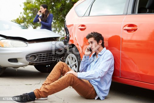 istock Teenage Driver Making Phone Call After Traffic Accident 475390281