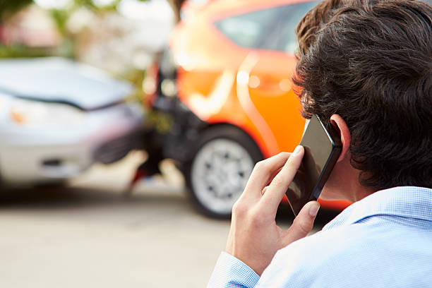 teenage driver making phone call after traffic accident - impaired driving stock photos and pictures