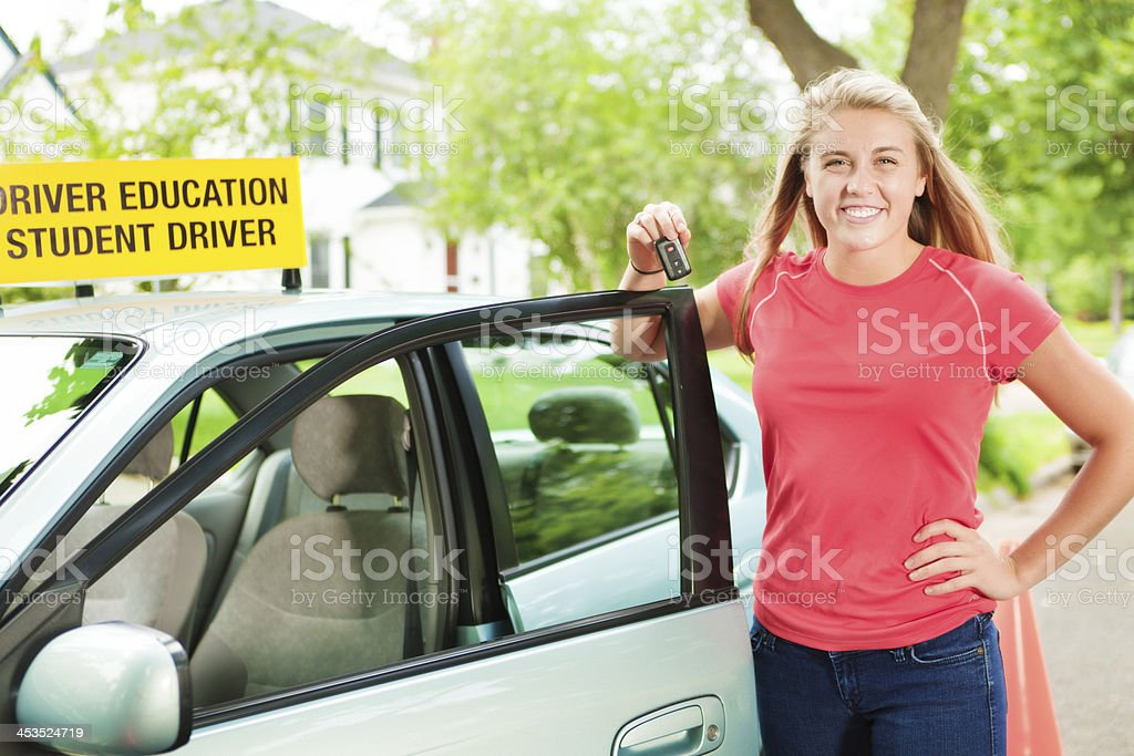 Teenage Driver Receive Key to Her First Car royalty-free stock photo