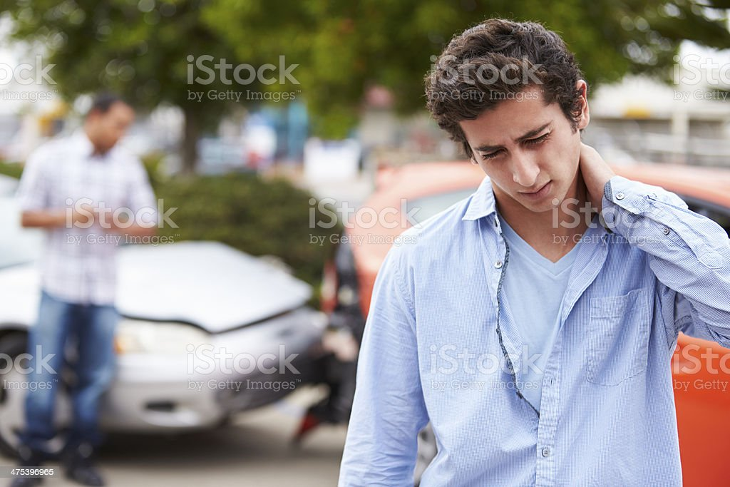 Teenage Driver Suffering Whiplash Injury Traffic Accident stock photo