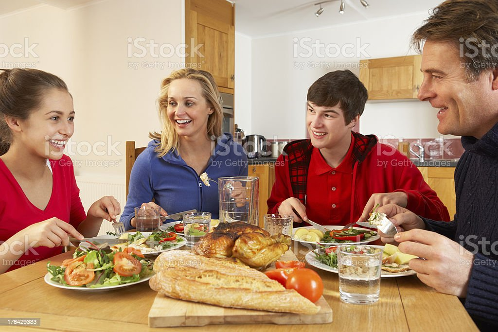 Teenage Family Eating Lunch Together In Kitchen royalty-free stock photo