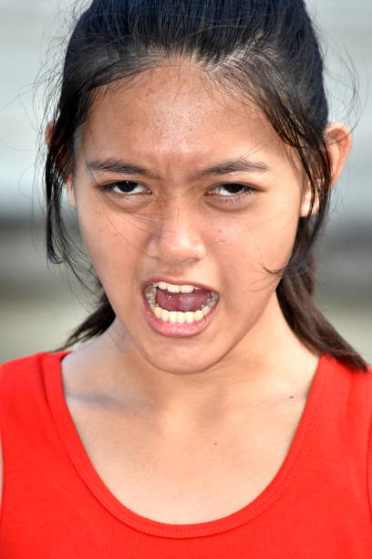 A Teenage Female And Anger A person in an outdoor setting antagonize stock pictures, royalty-free photos & images