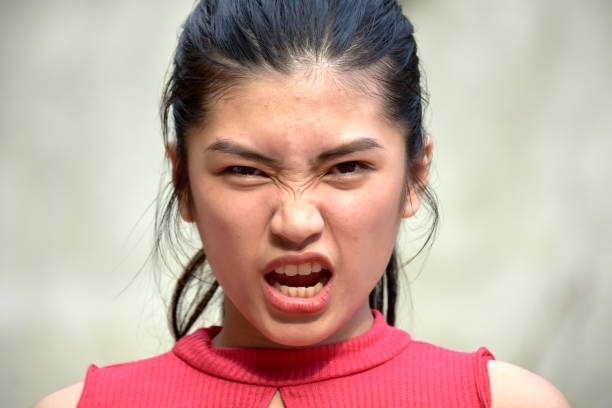 Teenage Female And Anger A person in an outdoor setting antagonize stock pictures, royalty-free photos & images