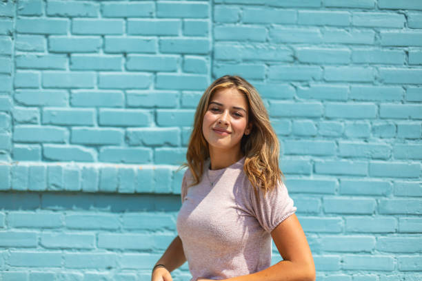 Teenage Female Standing in Front of Blue Brick Wall Urban Photo Series In Western Colorado Teenage Female Standing in Front of Blue Brick Wall Urban Photo Series Urban (Shot with Canon 5DS 50.6mp photos professionally retouched - Lightroom / Photoshop - original size 5792 x 8688 downsampled as needed for clarity and select focus used for dramatic effect) eyecrave stock pictures, royalty-free photos & images