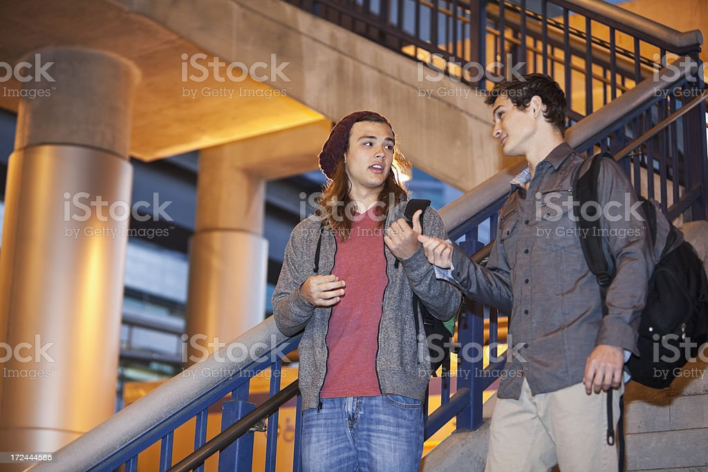 Teenage friends going down stairs royalty-free stock photo