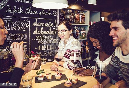 Teenage friends having fun at the snack bar, Ljubljana, Slovenia