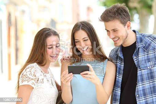 istock Teenage friends watching media on a smartphone 1080773950