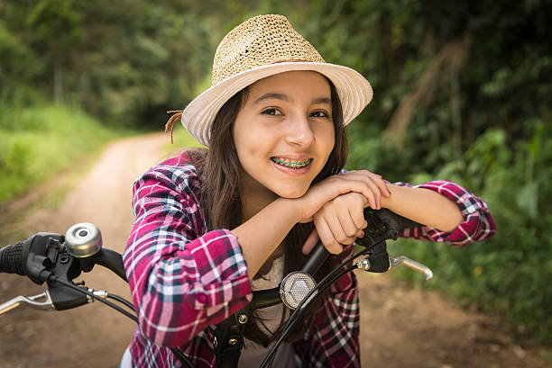 Teenage girl and bicycle stock photo