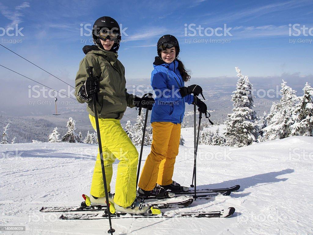 Teenage girl and boy skiing royalty-free stock photo