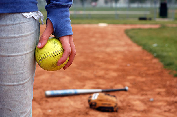 teenage girl and her softball, glove, bat - softball stock photos and pictures