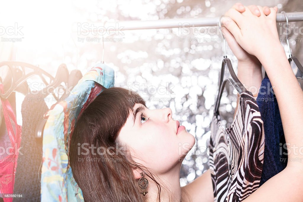 teenage girl and her wardrobe, with bokeh stock photo