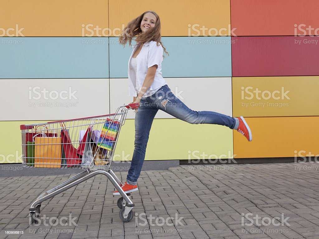 teenage girl and shopping cart stock photo