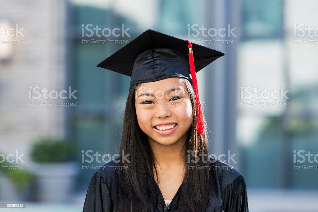 Teenage girl  at high school graduation stock photo