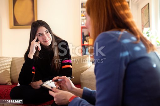 Teenage girl talks with therapist about interpersonal relationships