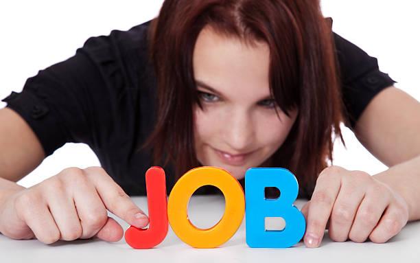 Teenage girl builds the term job stock photo