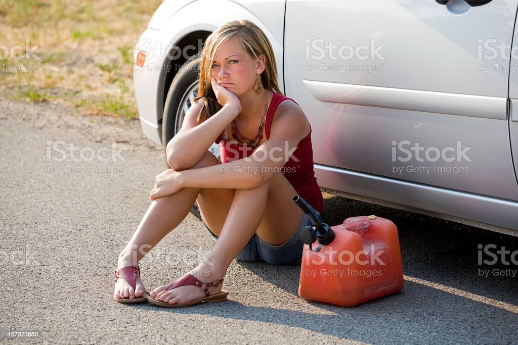 Teenage Girl by a Stalled Car stock photo