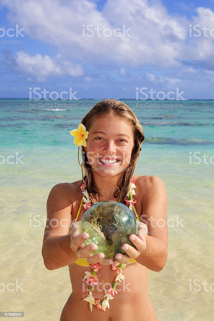 teenage girl by the ocean with glass fishnet ball royalty-free stock photo