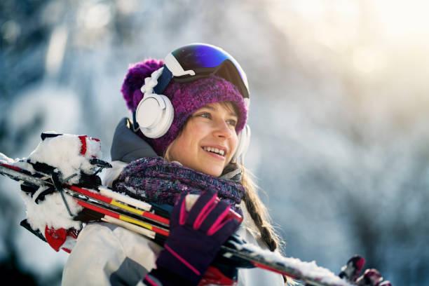 Teenage girl carrying skis on a winter day picture id1059769850?b=1&k=6&m=1059769850&s=612x612&w=0&h=mp652ydkhhagbsjkaw1znrjlpah0xtvpg1shq11ikl4=