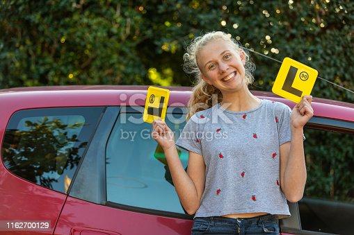 Teenage Girl Celebrating Learning to Drive