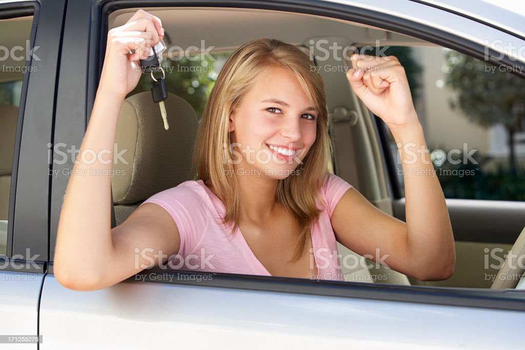 Teenage Girl Celebrating Owning First Car stock photo