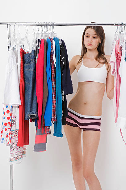 a teenage girl choosing clothes - underwear stock photos and pictures