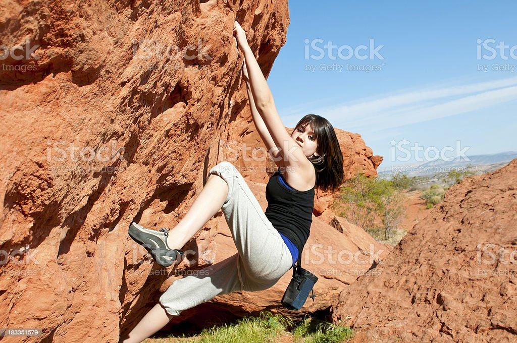 Teenage girl climbing boulder in Utah - III stock photo