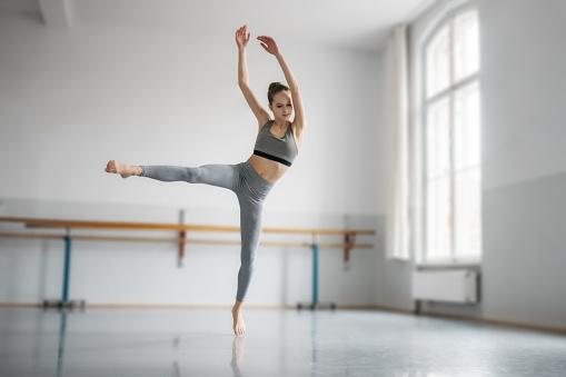 istock teenage girl dancing ballet in studio 880763126