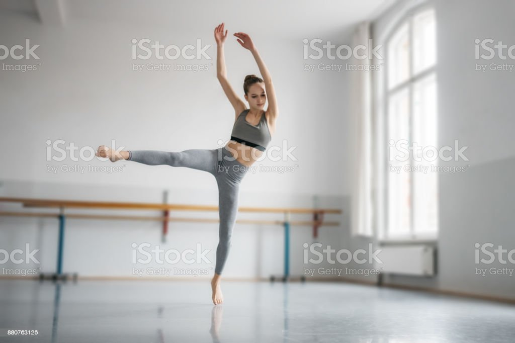 teenage girl dancing ballet in studio stock photo
